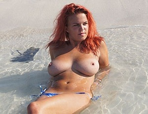 sexy red haired laura topless in the water